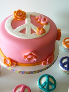 Peace sign cake and cupcakes